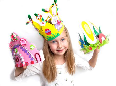 tresure: Little girl demonstrating her craft works and Easter bonnet