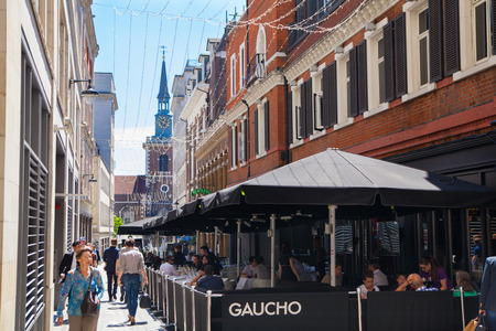 restaurant exterior: LONDON, UK - 22 JULY, 2014: Kingly st. going in parallel to Regent street. Famous shopping and restaurants aria