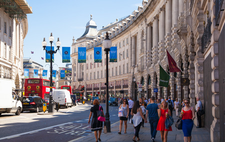 LONDON, UK - 22 JULY, 2014: People and traffic in Piccadilly Circus. Famous place for romantic dates. Square was built in 1819 to join to Regent Street