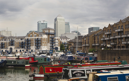 alicante: LONDON, UK - 3 JUNE 2014: Limehouse basin in the centre of London, private bay for boats and yatches and flats with Canary Wharf view