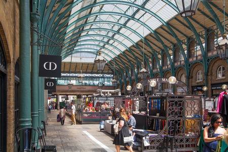covent: LONDON, UK - 22 JULY, 2014: Covent Garden market, one of the main tourist attractions in London, known as restaurants, pubs, market stalls, shops and public entertaining. Editorial