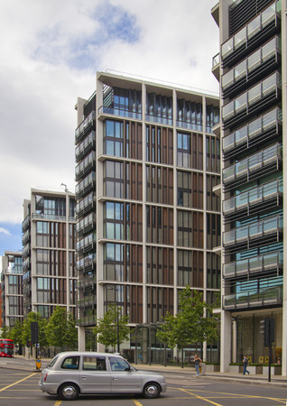 LONDON, UK - JULY 3, 2014: Expensive property in Kensington bridge and taxi