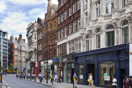 luxury goods: LONDON, UK - JUNE 3, 2014: Harrods department store, shopping and restaurants tourists point. Harrods was opened at 1849