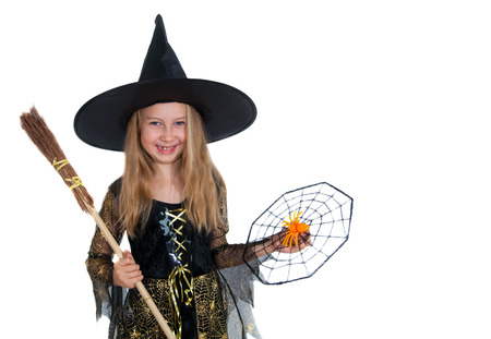 Girl posing in witch dress, Halloween little witch photo
