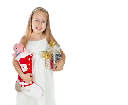 feelings and emotions: Happy little girl with Christmas presents