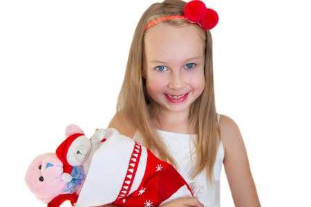 Happy little girl with Christmas presents photo
