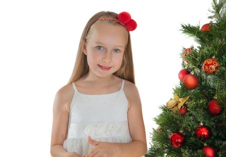 Happy little girl and Christmas tree photo