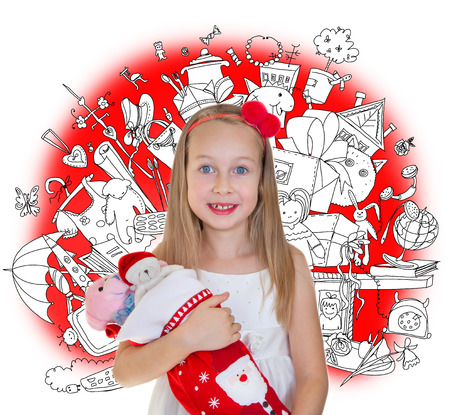 Little girl holding Christmas presents and doodle background with lots of toys photo