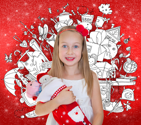 lots: Little girl holding Christmas presents and doodle background with lots of toys Stock Photo
