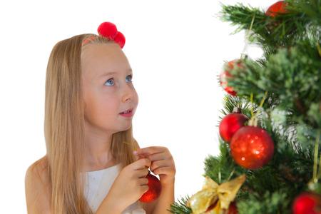Happy little girl with Christmas tree photo