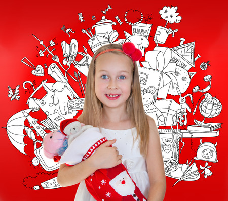 Little girl with Christmas presents photo