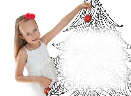 Little girl with Christmas tree photo
