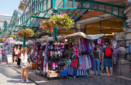 covent garden market: LONDON, UK - 22 JULY, 2014: Covent Garden market, one of the main tourist attractions in London, known as restaurants, pubs, market stalls, shops and public entertaining. Editorial