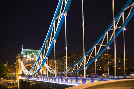 LONDON, UK - AUGUST 11, 2014: Tower bridge on the river Thames in night lights