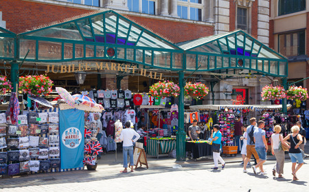 souvenir traditional: LONDON, UK - 22 JULY, 2014: Souvenirs shops in Covent Garden market, one of the main tourist attractions in London, known as restaurants, pubs, market stalls, shops and public entertaining.