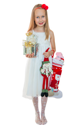 Little girl and Christmas presents photo