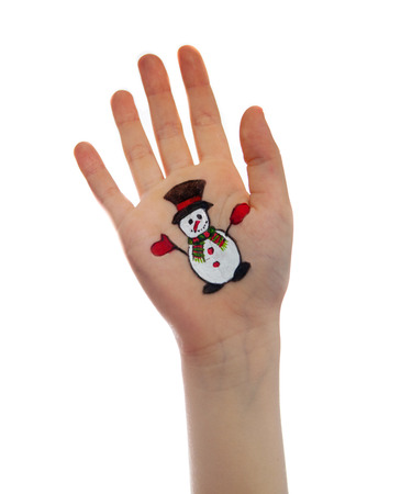 Snowman painted on child hand. Hand raised up. Christmas concept photo
