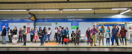 subway station: MADRID, SPAIN - MAY 28, 2014: Madrid tube station, train arriving on a platform