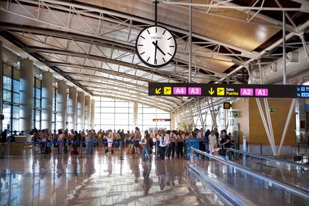 waiting passengers: MADRID, SPAIN - MAY 28, 2014: Interior of Madrid airport, departure waiting aria