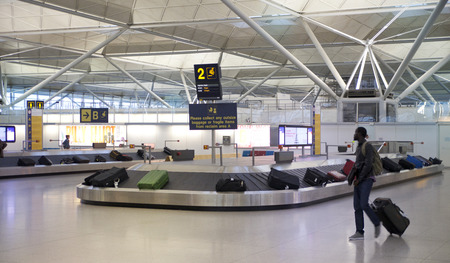 waiting area: LONDON, UK - MAY 28, 2014: Stansted airport, luggage waiting area