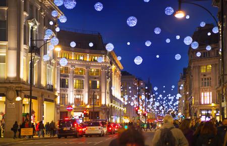 regent: LONDON, UK - NOVEMBER 30, 2014: Christmas lights on Regent street with crowd of people making christmas shopping