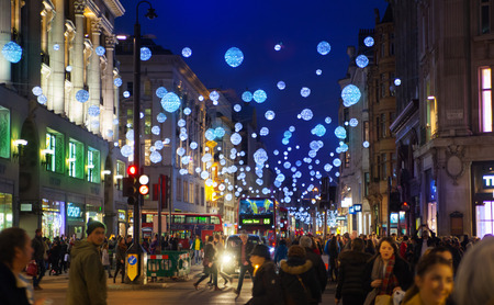 city lights: LONDON, UK - NOVEMBER 30, 2014: Black Friday weekend in London the first sale before Christmas. Oxford treet beautifully decorated with Christmas lights.