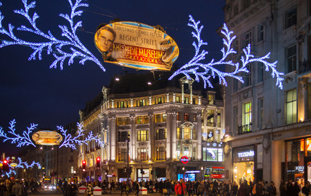 LONDON, UK - NOVEMBER 30, 2014: Black Friday weekend in London the first sale before Christmas. Regent street beautifully decorated with Christmas lights.