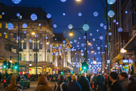 bargain hunting: LONDON, UK - NOVEMBER 30, 2014: Black Friday weekend in London the first sale before Christmas. Oxford treet beautifully decorated with Christmas lights.