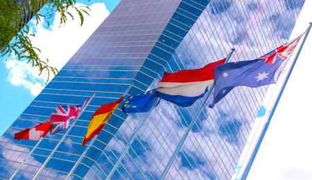 MADRID, SPAIN - July 22, 2014: International flags against of modern skyscrapers
