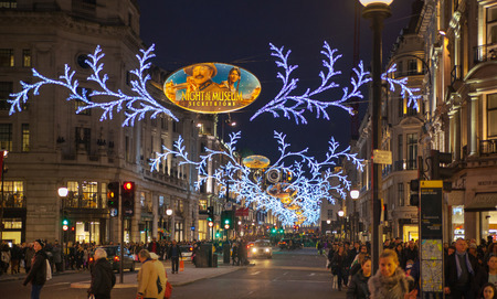 bargain hunting: LONDON, UK - NOVEMBER 30, 2014: Black Friday weekend in London the first sale before Christmas. Regent street beautifully decorated with Christmas lights. Roads were open for pedestrians only