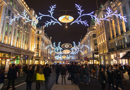 taxi famous building: LONDON, UK - NOVEMBER 30, 2014: Black Friday weekend in London the first sale before Christmas. Regent street beautifully decorated with Christmas lights. Roads were open for pedestrians only