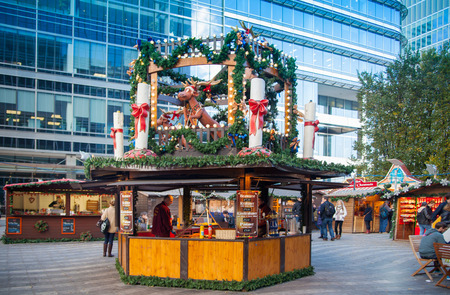 fun fair: LONDON, UK - NOVEMBER 29, 2014 - Canary Wharf square, traditional fun fair with stools, cafe, prises to win and Christmas activity. Editorial