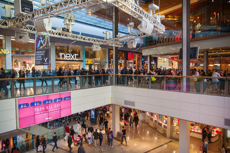 stratford: LONDON, UK - NOVEMBER 29, 2014: Westfield Stratford City Shopping centre with lots of people rushing for Christmas sale.