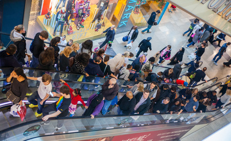 LONDON, UK - NOVEMBER 29, 2014: Westfield Stratford City Shopping centre with lots of people rushing for Christmas sale.