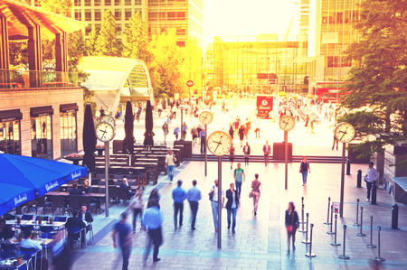corner clock: LONDON, UK - JULY 03, 2014: People blur. Office people moving fast to get to work at early morning in Canary Wharf aria
