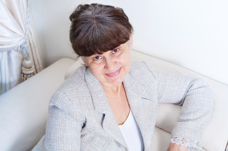 experiencing: Pension age good looking woman portrait Stock Photo