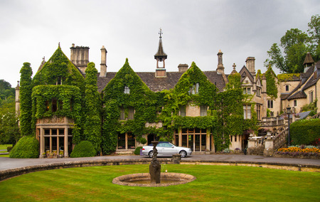 country club: CHIPPENHAM, UK - AUGUST 9, 2014: Castle Combe, unique old English village. Old house Editorial