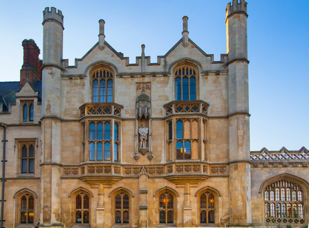 university fountain: CAMBRIDGE, UK - JANUARY 18, 2015: Kings college (started in 1446 by Henry VI). Historical buildings