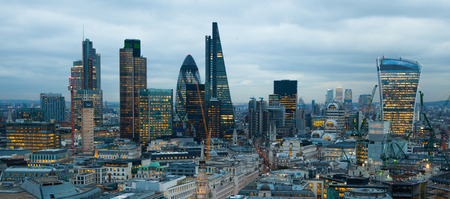 LONDON, UK - JANUARY 27, 2015: City of London, business and banking aria. London\'s panorama in sun set. View from the St. Paul cathedral