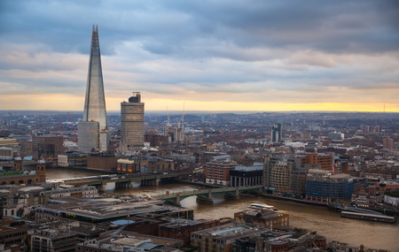 shard of glass: LONDON, UK - JANUARY 27, 2015: Shard of glass. City of London, business and banking aria. Londons panorama in sun set. View from the St. Paul cathedral