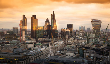 LONDON, UK - JANUARY 27, 2015: City of London, business and banking aria. Londons panorama in sun set. View from the St. Paul cathedral