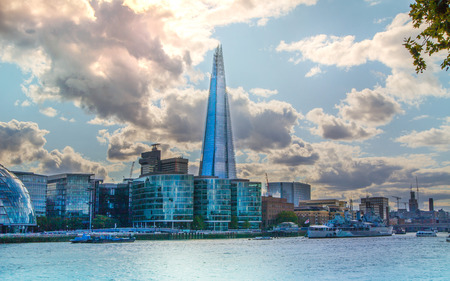 partment: LONDON, UK - AUGUST 16, 2014: Shard of glass on river Thames. Modern London architecture Editorial