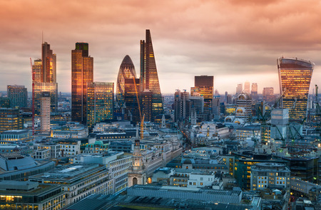 panorama city panorama: LONDON, UK - JANUARY 27, 2015: City of London, business and banking aria. Londons panorama in sun set. View from the St. Paul cathedral
