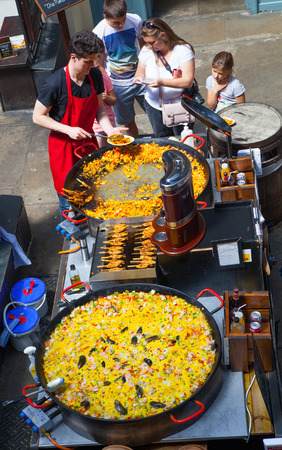 british food: LONDON, UK - 22 JULY, 2014: Paella in Covent Garden market, one of the main tourist attractions in London, known as restaurants, pubs, market stalls, shops and public entertaining.