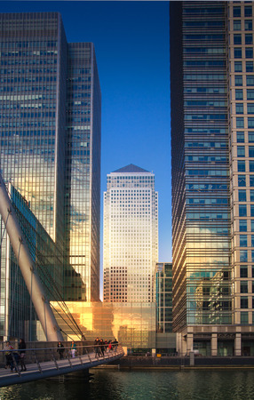tall buildings: LONDON, UK - NOVEMBER 29, 2014: Canary Wharf modern glass architecture of famous office buildings Editorial