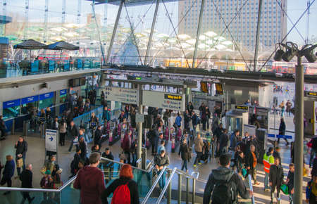 tubes: LONDON, UK - NOVEMBER 29, 2014: Stratford international train and tube station, one of the biggest transport junction of London and UK. Main hall with lots of people