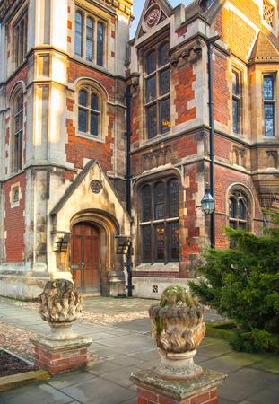 university fountain: CAMBRIDGE, UK - JANUARY 18, 2015: Pembroke college, university of Cambridge. The inner courtyard with church