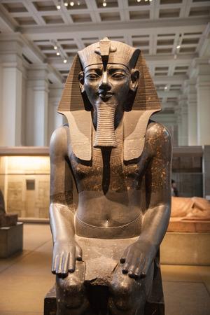 antiquity: LONDON, UK - NOVEMBER 30, 2014: British museum Egyptian sculpture hall, Pharaoh Rameses Editorial