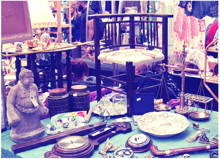 LONDON, UK - MAY 15, 2014: Antique display Greenwich market. Famous place to buy an art, crafts, antiques etc. Editorial