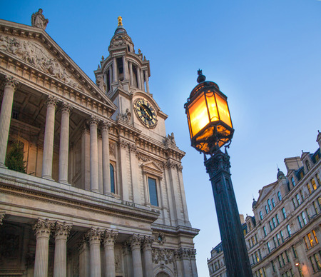 british touring car: LONDON, UK - DECEMBER 19, 2014: City of London. St. Paul cathedral in dusk. Editorial